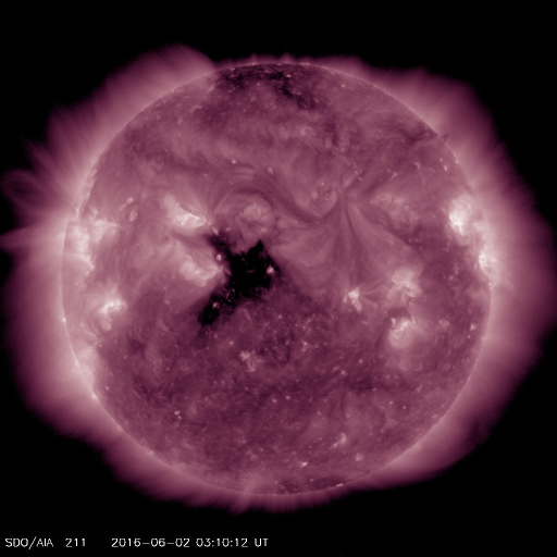 The Dark area in center disk is the coronal hole that may produce aurora on June 4